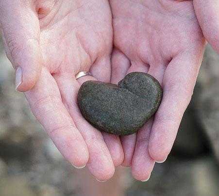 heart shaped rock in hands